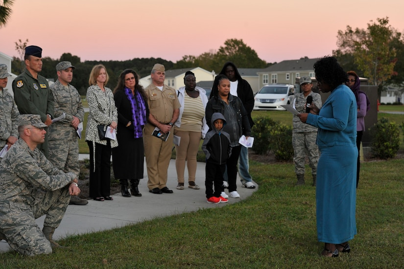 Dr. Karen Simmons shares her story of domestic violence during a candlelight vigil ceremony at Joint Base Charleston, S.C., Oct. 19, 2015. The ceremony included lighting of candles, eight victims' stories and a balloon release. (U.S. Air Force photo/Tech. Sgt. Renae Pittman)