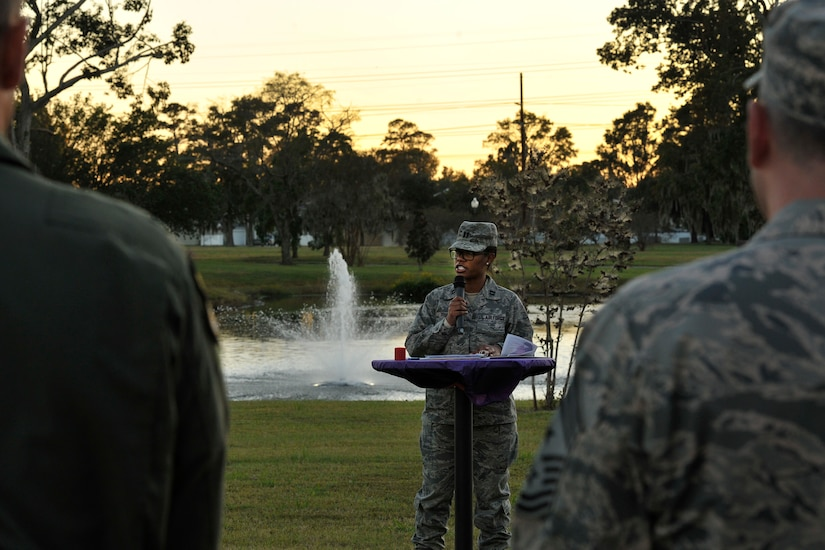 Capt. Sheontee Frank, 628th Medical Group Family Advocacy officer, provides opening remarks for this year's domestic violence candlelight vigil at Joint Base Charleston, S.C., Oct. 19, 2015. The ceremony was held in remembrance of all those who have been affected by domestic violence. (U.S. Air Force photo/Tech. Sgt. Renae Pittman)