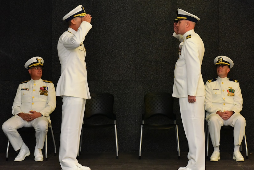 Rear Adm. James M. Heinz, second from left, the director of operational logistics for the Coast Guard, salutes Cmdr. Michael J. Paradise, second from right, the commanding officer of Coast Guard Base Charleston, S.C., during a ceremony at the Federal Law Enforcement Training Center in Charleston, Oct. 19, 2015. The ceremony was held to observe the establishment of Coast Guard Base Charleston, which will integrate mission support activity and align logistics in the northern areas of the 7th Coast Guard District. (U.S. Coast Guard photo by Petty Officer 2nd Class Anthony L. Soto)