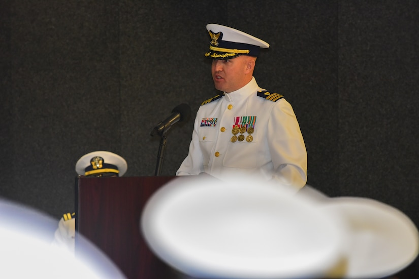 Cmdr. Michael J. Paradise, the commanding officer of Coast Guard Base Charleston, S.C., addresses guests during the base establishment ceremony at the Federal Law Enforcement Training Center in Charleston Oct. 19, 2015. CG Base Charleston was established to integrate mission support activity and align logistics in the northern areas of the 7th Coast Guard District. (U.S. Coast Guard photo by Petty Officer 2nd Class Anthony L. Soto)