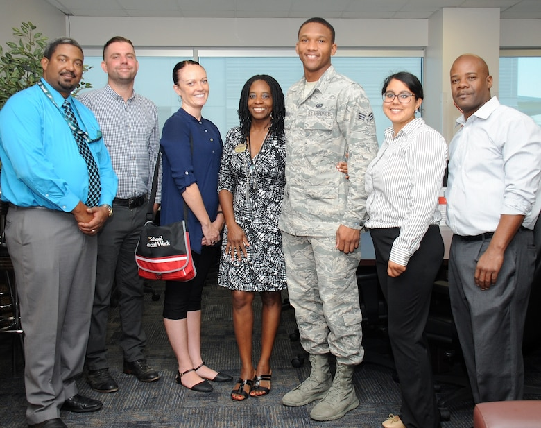 From left to right, Marc Person, 61st Force Support Squadron Airman and Family Readiness Center, student interns Jason Woodrum and Dejha Harris from the University of Southern California's Adults and Healthy Aging Department, Cathy Howard, 61st FSS director of the Airman and Family Readiness Center, Senior Airman Gerard Listhrop from the Space and Missile Systems Center's Financial Management Directorate, student interns Rebecca Dardon from USC's Community, Organization, Planning and Administration Department and John Howard from USC's Adults and Healthy Aging Department take a group photo during an introductory reception Sept. 9 hosted in the A&FRC at Los Angeles Air Force Base in El Segundo, Calif. A partnership between USC's Masters in Social Work program and the Space and Missile Systems Center at Los Angeles AFB will play a critical role in preparing future graduates for contemporary clinical issues in their chosen profession by providing.an understanding of military culture and the commitment that is made by the men and women of the armed forces, as well as the sacrifices of their families. (U.S. Air Force photo/Van De Ha).