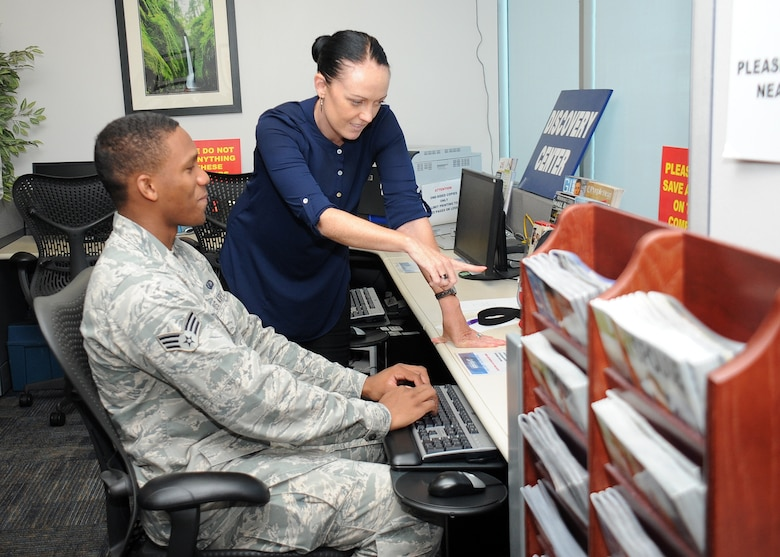 Dejha Harris from the University of Southern California's Adults and Healthy Aging Department assists Senior Airman Gerard Listhrop from the Space and Missile Systems Center's Financial Management Directorate in gathering relocation assistance information from the Airman and Family Readiness Center's Discovery Center at Los Angeles Air Force Base in El Segundo, Calif. A partnership between USC's Masters in Social Work program and SMC at Los Angeles AFB will play a critical role in preparing future graduates for contemporary clinical issues in their chosen profession by providing.an understanding of military culture and the commitment that is made by the men and women of the armed forces, as well as the sacrifices of their families. (U.S. Air Force photo/Van De Ha)