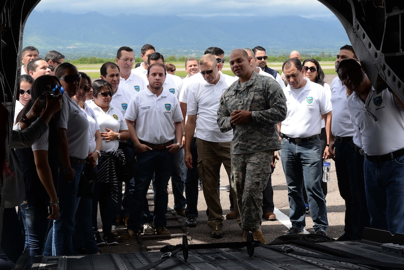 U.S. Army Sgt. Jesse Gomez, 1-228 aviation regiment, explains how the CH-47 Chinook helicopter works for the Honduran Defense College during a visit to Soto Cano Air Base, Honduras, Oct. 16, 2015. The visit provided a better understanding of JTF-Bravo's mission and capabilities for the Defense College members. (U.S. Air Force photo by Senior Airman Westin Warburton/Released)