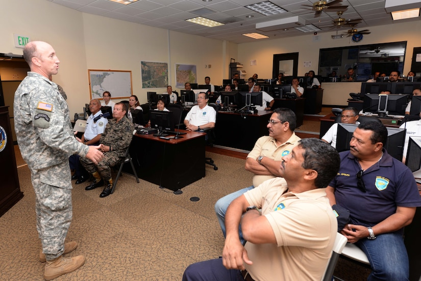U.S.  Army Col. Robert J. Harman, Joint Task Force-Bravo commander, speaks to members from the Honduran Defense College during a visit to Soto Cano Air Base, Honduras, Oct. 16, 2015. The visit provided a better understanding of JTF-Bravo's mission and capabilities for the Defense College members. (U.S. Air Force photo by Senior Airman Westin Warburton/Released)