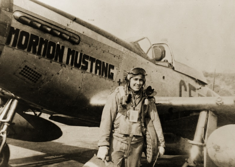 Roland R. Wright stands next to the P-51 Mormon Mustang he made his name flying in over Europe in WWII. Wright shot down three enemy aircraft during the war.