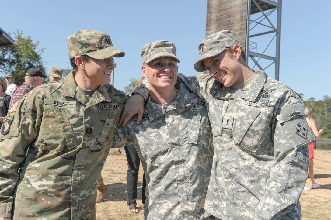 Army Capt. Kristen Griest, Maj. Lisa Jaster and 1st Lt. Shaye Haver share a moment following Jaster's graduation from Ranger School