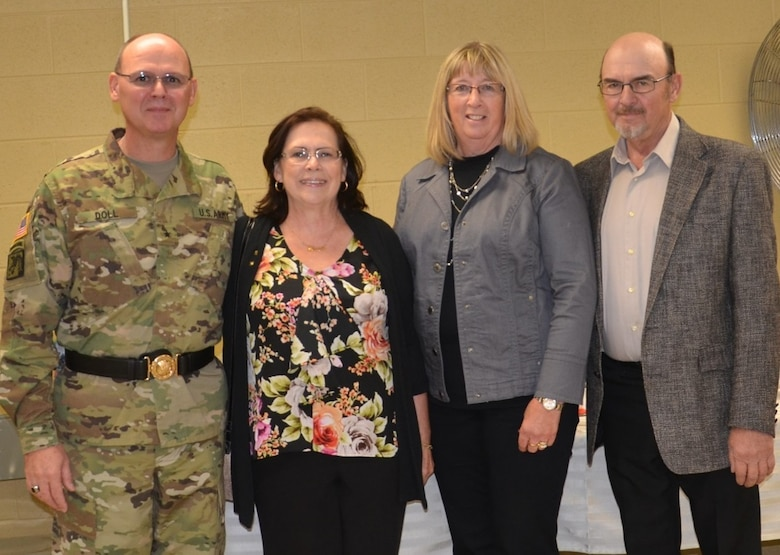(pictured left to right) Brig. Gen. Jeffrey Doll, incoming commander of the Army Reserve Sustainment Command of Birmingham, Ala. with his wife, Karen Doll, his sister-in-law Cathy Doll, and his brother Pat Doll, both of North Dakota celebrate with Doll during the ARSC's Assumption of Command Ceremony on Oct. 17.