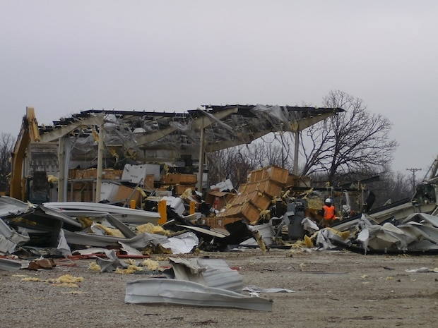 """Extensive damage documented by the 88th Regional Support Command of Equipment Concentration Site – 66 at Fort Leonard Wood, Mo., after being struck by a tornado on Dec. 31, 2010. Continuity of Operation Plans allow the 88th RSC to maintain mission essential functions in this type of emergency. In order to be prepared for future emergencies, the 88th RSC's Crisis Action Team members conducted a Continuity of Operations Plan Exercise on Fort McCoy, Wis., Oct.14. Charles Hudson, 88th Regional Support Command chief of staff said he knows firsthand how important it is to have a COOP in place in the event of a natural disaster.  """"The COOP's priority of effort is to ensure mission essential functions are met,"""" Hudson said, """"and then to ensure minimum degradation of customer support to commands within the 88th RSC geographic area of responsibility.""""   """"The ability to implement the COOP was instrumental to recovery operations at Equipment Concentration Site – 66 at Fort Leonard Wood when it was struck by a tornado on December 31st, 2010,"""" Hudson explained.  """"Fortunately this was a Federal Holiday or we would have experienced loss of life.  As it was, we lost $2.7M in equipment destroyed, $3.4M in equipment damage, and $5.5M in facilities repair and replacement,"""" Hudson continued.  """"We accounted for 100% of ECS personnel that day, none were impacted personally, and most were called in to work over the weekend to secure equipment and facilities, account for property and begin the slow recovery process,"""" Hudson said.  """"It took nearly a year for ECS-66 to recover from this event and much of that time was spent operating in temporary facilities elsewhere on Fort Leonard Wood. In addition, warehouse operations had to move 140 miles to an available warehouse at Weldon Springs Local Training Area in Saint Charles, Mo., Hudson said.  """"Given this real-world scenario,"""" Hudson said, """"a COOP for the 88th RSC Headquarters is very important."""""""