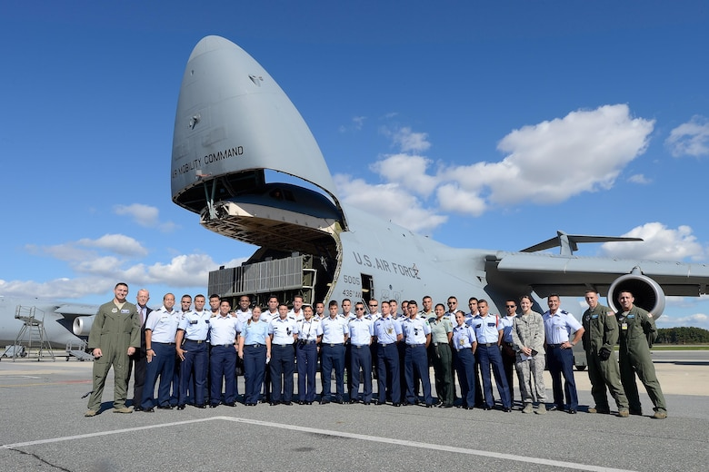 Latin American cadets, hosts from the Office of the Secretary of the Air Force's International Affairs Office and personnel from the 436th Airlift Wing, stand in front of a C-5M Super Galaxy Oct. 15, 2015, at Dover Air Force Base, Del. The nose of the aircraft is in the raised position as part of the demonstration given to the cadets showing how heavy equipment can roll-on/roll-off of the cargo transport aircraft. (U.S. Air Force photo/Greg L. Davis)