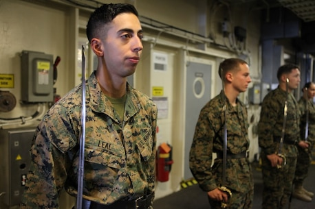 Cpl. Ritchie Leal, a motor transport operator for Koa Moana 15-3, practices sword manual during Corporal's Course aboard the USNS Lewis and Clark, Sept. 12. Leal also serves as a messman for the exercise.