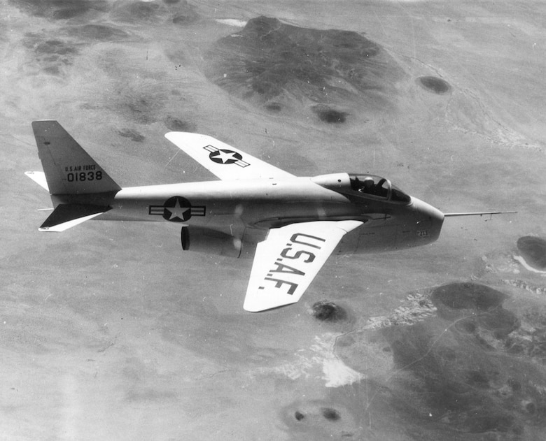 The museum's X-5 flying with its wings swept fully forward, which allowed it to take off and land in a shorter distance, land at a lower speed, and climb faster. With the wings swept back, it could fly faster. (U.S. Air Force photo)