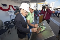PASCAGOULA, Miss. - The keel of the future USS Paul Ignatius (DDG 117) is authenticated by the ship's namesake, the Honorable Paul Ignatius (left) and Mr. Bill Jones, the Hull Superintendent (right) during a ceremony Oct. 20. Both authenticators etched their initials into the keel plate to symbolically recognize the joining of modular components and the ceremonial beginning of the ship. Paul Ignatius, a Flight IIA ship, is the first ship in the FY2013-FY2017 multi-year procurement contract to start fabrication and is scheduled to deliver in 2018. The ship will serve as an integral player in global maritime security, engaging in air, undersea, surface, strike and ballistic missile defense. (US Navy Photo released)