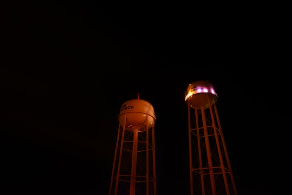 """Purple lights illuminate one of two water towers on Laughlin Air Force Base, Texas, Oct. 21, 2015. The outcome of """"Purple Light Nights"""" each year during October's Domestic Violence Awareness Month is to increase the awareness of domestic violence issues and it's affect upon children and families and to further impress upon the mission to """"Remember, the victims who lost their lives from domestic violence; Support those who survived domestic violence; and Hope for those still living with abuse."""" (U.S. Air Force photo by Tech. Sgt. Steven R. Doty)(Released)"""