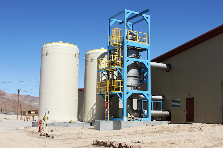 The phase separator of the mechanical evaporator located on the right of side of the photo is the third stage of the purification process. The project is the design-build of a six million gallon per day water treatment plant. The new plant will use a three-stage, electro-dialysis reversal (EDR) water treatment plant that treats all contaminants found in Fort Irwin's ground water in accordance with federal and state requirements. The plant will include: an electro-dialysis reversal (EDR) primary treatment, lime softening clarifiers, lime solids thickeners, lime sludge lagoons, reverse osmosis (RO) filters, brine treatment facility, concentrate equalization basins and a mechanical evaporator tower and feed tank, and three evaporation ponds to achieve the post's 99 percent water recovery rate. The project also includes water system improvement and supporting utilities and infrastructure upgrades