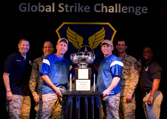Col. John T. Wilcox, 341st Missile Wing commander, accepts the Blanchard Trophy for the best ICBM wing in the Air Force on behalf of the Airmen of Malmstrom Air Force Base, Mont., at the 2015 Global Strike Challenge trophy presentation at Barksdale AFB, La., Oct. 21, 2015. Global Strike Challenge is the nation's premier bomber, ICBM, helicopter operations and security forces competition with units from Air Force Global Strike Command, Air Combat Command, Air Force Reserve Command and the Air National Guard. (U.S. Air Force photo/Senior Airman Joseph Raatz)