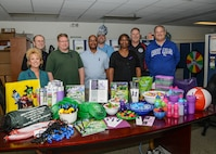 Edwards AFB Emergency Management filled and donated goodie bags, complete with candy, to local children who have been victims of domestic violence and will not be able to go trick or treating this year. The items included Air Force Be Ready coloring books, Frisbees, whistles and more. Donations of candy came in from various individuals in the Emergency Management Office. (U.S. Air Force photo by Rebecca Amber)