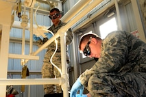 Staff Sgts. Derek Mclemore, left, and Jermey Manning, 2nd Logistics Readiness Squadron fuels laboratory technicians, record how much fuel is taken from Pump House 1 at Barksdale Air Force Base, La., Oct. 14, 2015. Fuel lab technicians not only guarantee fuel is clean and ready for use but also that the right amount of fuel can be transported when needed. (Air Force Photo/Airman 1st Class Luke Hill)