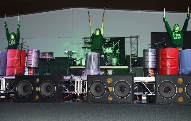 The punk rock percussion band Street Drum Corps performs for service members and their families Oct. 20, 2015, at Andersen Air Force Base, Guam. The free event was hosted by Navy Entertainment and drew a crowd of 150 people. (U.S. Air Force photo by Airman 1st Class Arielle Vasquez/Released)
