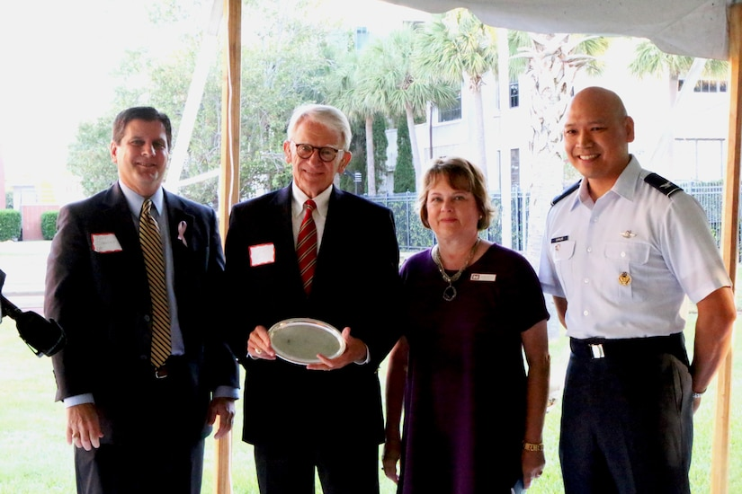 (Left to right) Scott Isaacks, Ralph H. Johnson VA Medical Center director,  Joe Riley, Charleston mayor, Glenn Jeffries, USACE Corporate Communication director and Col. Jimmy Canlas, 437th AW deputy commander, pose for a photo during the first annual Federal Executive Association of the Greater Charleston Area stakeholder meet-and-greet event at U.S. Coast Guard Sector, Charleston, S.C.  The FEA is comprised of the leadership from 40 military and civilian federal entities in the Charleston area. Jeffries and Canlas are the current FEA co-chairs. (Courtesy Photo)