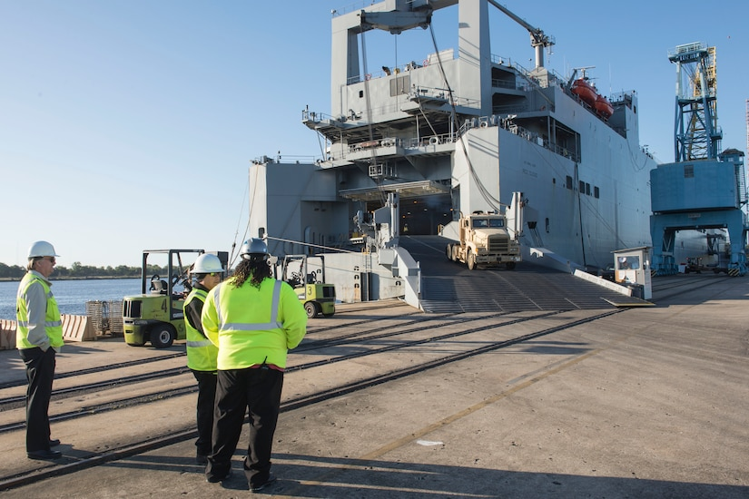 The United States Naval Ship Red Cloud is docked at Joint Base Charleston – NWS, S.C. for its maintenance cycle on Oct. 20, 2015. Representatives from Honeywell, International Long Shoreman's Association, Shippers Stevedoring Company and the 841st Transportation Battalion were all involved in the unloading process. (U.S. Air Force Photo/Airman 1st Class Thomas Charlton)