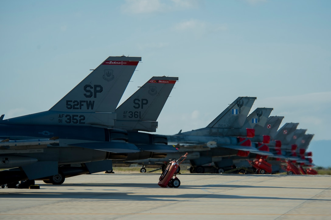 Two F-16 Fighting Falcon fighter aircraft, assigned to 480th Fighter Squadron, Spangdahlem Air Base, Germany, park next to F-16s from the Hellenic air force and Polish air force after the Trapani Air Show at Trapani Air Base, Italy, Oct. 19, 2015. The Trapani Air Show kicked off Trident Juncture 2015, a training exercise involving more than 30 Allied and Partner Nations taking place throughout Italy, Portugal, Spain, the Atlantic Ocean, the Mediterranean Sea, Canada, Norway, Germany, Belgium and the Netherlands. (U.S. Air Force photo by Airman 1st Class Luke Kitterman/Released)