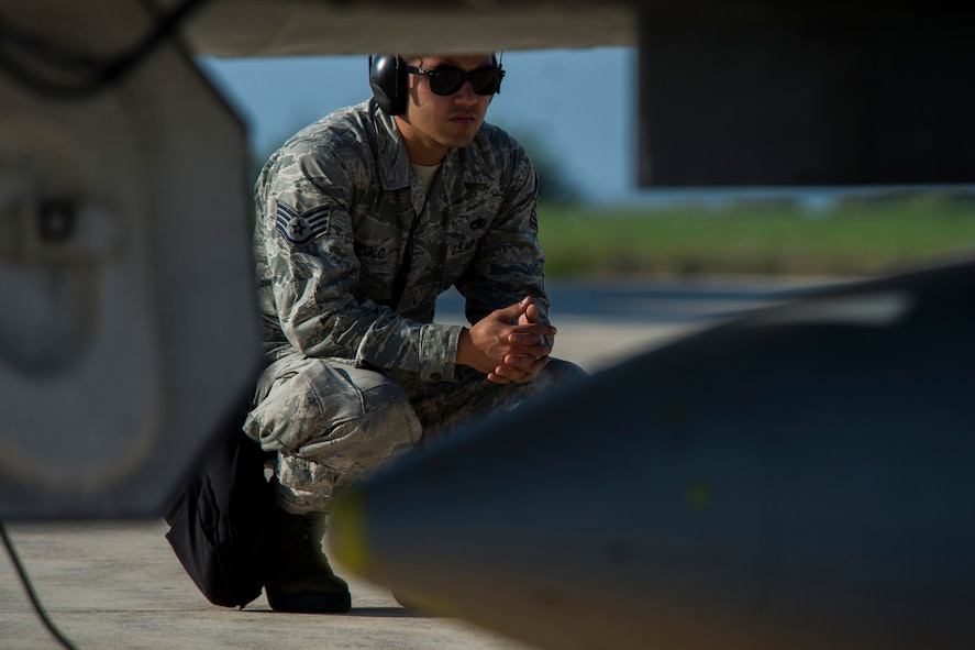 U.S. Air Force Staff Sgt. Joaquin Arevalo, a 52nd Aircraft Maintenance Squadron weapons load crew chief, looks over an F-16 Fighting Falcon fighter aircraft, assigned to 480th Fighter Squadron, Spangdahlem Air Base, Germany, before the start of the Trapani Air Show at Trapani Air Base, Italy, Oct. 19, 2015. The Trapani Air Show kicked off Trident Juncture 2015, a training exercise involving more than 30 Allied and Partner Nations taking place throughout Italy, Portugal, Spain, the Atlantic Ocean, the Mediterranean Sea, Canada, Norway, Germany, Belgium and the Netherlands. (U.S. Air Force photo by Airman 1st Class Luke Kitterman/Released)