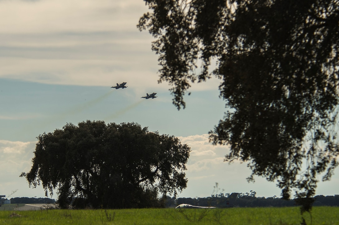 BEJA AIR BASE, Portugal - Two F-16 fighter aircraft fly over the Beja Air Base, Portugal  flightline Oct. 21, 2015. Several F-16 Fighting Falcon fighter aircraft, pilots and support personnel assigned to the 52nd Fighter Wing, Spangdahlem Air Base, Germany, are here to participate in Exercise Trident Juncture 2015, a multiservice, multinational exercise geared toward demonstrating NATOs ability to respond on a large scale to a crisis scenario. (U.S. Air Force photo by Airman 1st Class Luke Kitterman/Released)