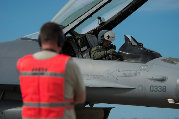 BEJA AIR BASE, Portugal - An F-16 Fighting Falcon fighter aircraft pilot from the 480th Fighter Squadron, Spangdahlem Air Base, Germany, conducts pre-flight checks before take off at Beja Air Base, Portugal, Oct. 21, 2015. The 480th FS is here in support of Exercise Trident Juncture 2015, a multinational exercise consisting of more than 30,000  troops from more than 30 nations. The exercise is geared toward demonstrating ability to respond on a large scale to a crisis scenario. (U.S. Air Force photo by Airman 1st Class Luke Kitterman/Released)