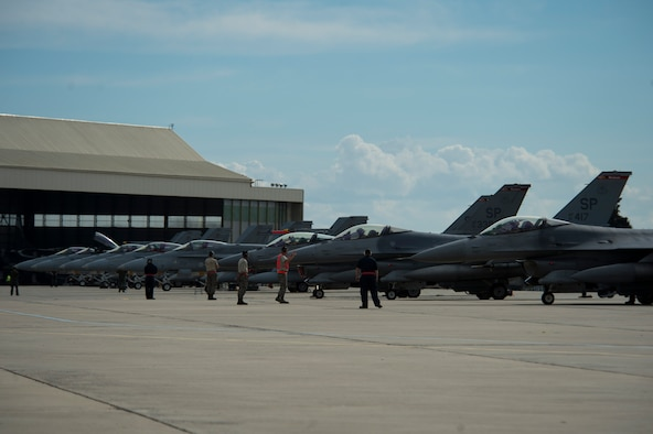 BEJA AIR BASE, Portugal - F-16 fighter aircraft from multiple nations perform last-minute checks before take off in support of Exercise Trident Juncture 15 at Beja Air Base, Portugal, Oct. 21, 2015. More than 30 NATO and partner nations are participating in this year's exercise. Exercises like Trident Juncture 15 ensures America's commitment to security in the region.  (U.S. Air Force photo by Airman 1st Class Luke Kitterman/Released)
