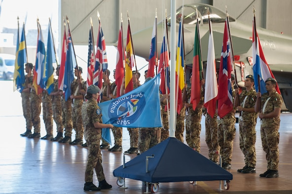Opening Ceremony of Exercise Trident Juncture at Trapani Air Base, Italy. Rising of the Trident Juncture 2015 flag. More than 5,000 U.S. service members will participate in NATO's Trident Juncture 2015 exercise conducted in Spain, Portugal and Italy, Belgium, Canada, Germany, The Netherlands, Norway and at sea, in the Atlantic Ocean and Mediterranean Sea. Trident Juncture is the largest NATO LIVEX to be conducted in the past 20 years, and serves as an annual NATO Response Force (NRF) certification exercise for 2016.  The U.S. Army, Air Force, Navy and Marine Corps and Special Operations personnel supporting the exercise will arrive from European and CONUS locations, to include some Army and Air National Guard assets. Special Operations Command Europe (SOCEUR), will be certified during this exercise and assume the role as the Special Operations Component Command for the NRF in 2016. Exercise Trident Juncture runs until Nov. 6, 2015.
