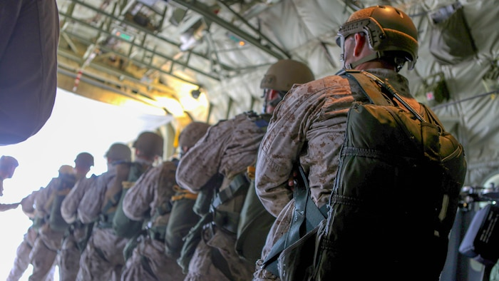 Marines with 1st Reconnaissance Battalion, 1st Marine Division conduct drills inside of a C-130 Hercules with 3rd Marine Aircraft Wing prior to static-line parachute operations and free fall jump training aboard Marine Corps Base Camp Pendleton, Calif., Oct. 16, 2015. 1st Recon conducted parachute operations in preparation for future deployments.