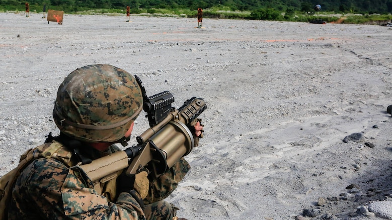 U.S. Marine Lance Cpl. Justin Sabey, a rifleman with Battalion Landing Team 2nd Battalion, 5th Marines, 31st Marine Expeditionary Unit, fires his M32 grenade launcher during live-fire training with Philippine Marines at Crow Valley, Philippines, Oct. 6, 2015. Philippine Marines with 31st Marine Company, Marine Battalion Landing Team 1, Armed Forces of the Philippines, and the U.S. Marines with BLT 2/5, 31st MEU, are training side by side as part of Amphibious Landing Exercise 2015, an annual bilateral training exercise conducted by members of the Armed Forces of the Philippines alongside U.S. Marine and Navy Forces.
