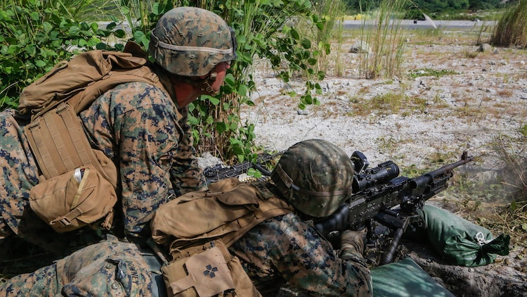 U.S. Marine Cpl. Ryan Downy, a machine gunner with Battalion Landing Team 2nd Battalion, 5th Marines, 31st Marine Expeditionary Unit, fires his M240 medium machine gun during live-fire training with Philippine Marines at Crow Valley, Philippines, Oct. 6, 2015. Philippine Marines with 31st Marine Company, Marine Battalion Landing Team 1, Armed Forces of the Philippines and the U.S. Marines with BLT 2/5, 31st MEU, are training side by side as part of Amphibious Landing Exercise 2015, an annual bilateral training exercise conducted by members of the Armed Forces of the Philippines alongside U.S. Marine and Navy Forces.