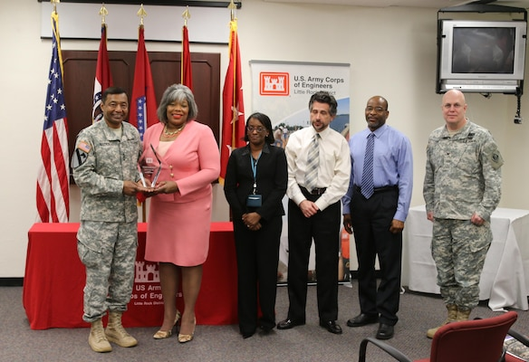 Lt. Gen. Thomas Bostick, U.S. Army Corps of Engineers commanding general presents the Fiscal Year 2014 Excellence in Contracting Awards Program, District of the Year Award to the Little Rock District contracting division.  Accepting the award is SWL Chief of Contracting Sandra Easter.