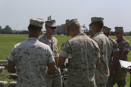 Capt. Nathan Daniel, an operational analyst with the Expeditionary Energy Office, leads a group of Marines with II Marine Expeditionary Force visiting the Expeditionary Energy Concepts, or E2C, demonstration aboard Camp Lejeune, N.C., June 24, 2015. E2C gave Marines an opportunity to learn about new technology and give their own feedback directly to the developers.