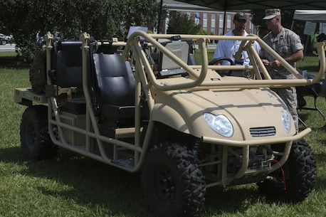 Master Sgt. Shawn Workman, an operational analyst with II Marine Expeditionary Force, speaks to a representative of one of the civilian companies responsible for designing an energy-efficient, all-terrain utility vehicle for the Marine Corps at the Expeditionary Energy Concepts demonstration aboard Camp Lejeune, N.C., June 24, 2015. E2C gives civilian and Department of Defense developers the opportunity to demonstrate technologies with potential to address gaps in Marines Corps energy, water and waste capabilities.