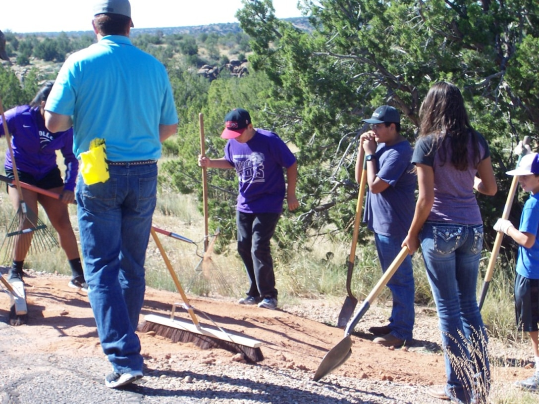 SANTA ROSA LAKE, N.M. – Volunteers work on trail clean up at the lake Sept. 26, 2015.