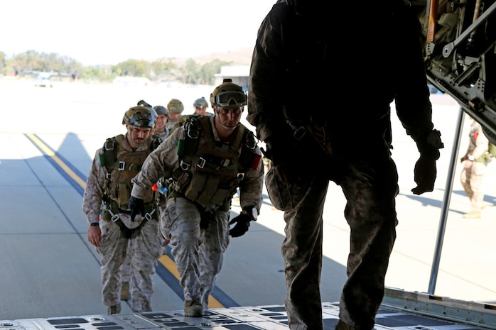 Marines with 1st Reconnaissance Battalion, 1st Marine Division enter a C-130 Hercules with 3rd Marine Aircraft Wing before executing static-line parachute operations and free fall jump training aboard Marine Corps Base Camp Pendleton, Calif., Oct. 16, 2015. 1st Recon conducted parachute operations in preparation for future deployments. (U.S. Marine Corps photo by Cpl. Demetrius Morgan/RELEASED)