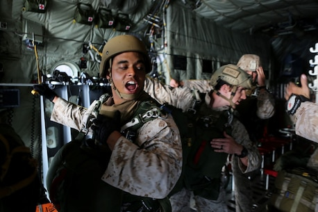 Corporal Kurtis Campbell, a jump team point man with 1st Reconnaissance Battalion, 1st Marine Division, relays commands to his team during static-line parachute operations aboard Marine Corps Base Camp Pendleton, Calif., Oct. 16, 2015. 1st Recon conducted parachute operations in preparation for future deployments. (U.S. Marine Corps photo by Cpl. Demetrius Morgan/RELEASED)