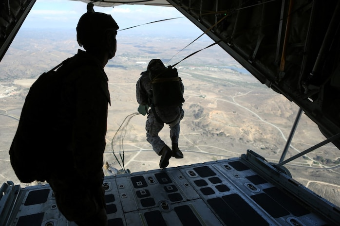 Marines with 1st Reconnaissance Battalion, 1st Marine Division conduct static-line parachute operations from a C-130 Hercules with 3rd Marine Aircraft Wing aboard Marine Corps Base Camp Pendleton, Calif., Oct. 16, 2015. 1st Recon conducted parachute operations in preparation for future deployments. (U.S. Marine Corps photo by Cpl. Demetrius Morgan/RELEASED)