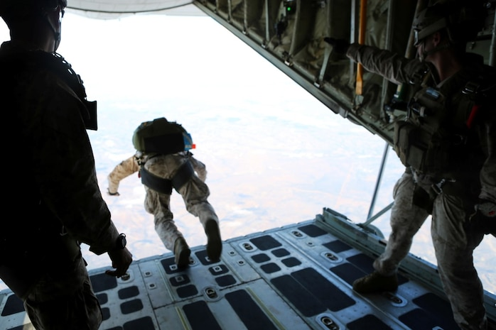 Marines with 1st Reconnaissance Battalion, 1st Marine Division conduct free fall jump training from a C-130 Hercules with 3rd Marine Aircraft Wing aboard Marine Corps Base Camp Pendleton, Calif., Oct. 16, 2015. 1st Recon conducted parachute operations in preparation for future deployments. (U.S. Marine Corps photo by Cpl. Demetrius Morgan/RELEASED)