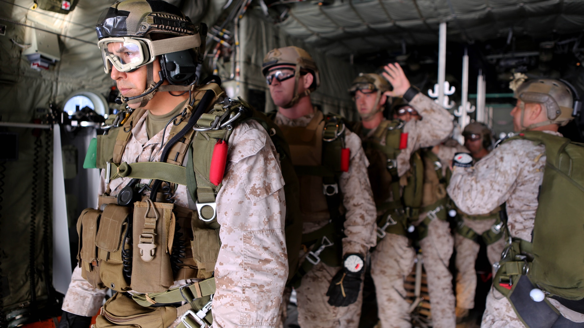 Marines with 1st Reconnaissance Battalion, 1st Marine Division prepare to conduct free fall jump training from a C-130 Hercules with 3rd Marine Aircraft Wing aboard Marine Corps Base Camp Pendleton, Calif., Oct. 16, 2015. 1st Recon conducted parachute operations in preparation for future deployments.