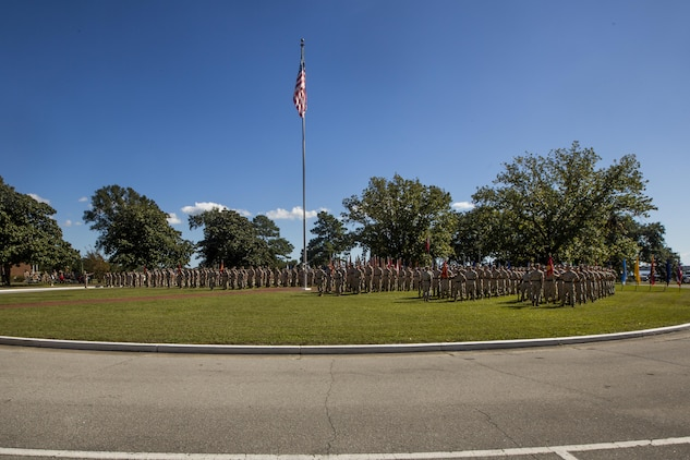 Marines and sailors with II Marine Expeditionary Force Headquarters Group, 2nd Marine Division, 2nd Marine Aircraft Wing, 2nd Marine Logistics Group, 22nd Marine Expeditionary Unit and 24th Marine Expeditionary Unit stand in formation during a change of command ceremony at Camp Lejeune, N.C., Oct. 22, 2015. During the ceremony, Maj. Gen. Walter L. Miller Jr., commanding general of II MEF, assumed command of II MEF from Maj. Gen. William D. Beydler.