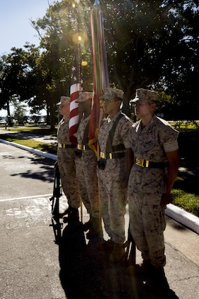 The II Marine Expeditionary Force color guard prepares to march on the colors during a change of command ceremony in which Maj. Gen. Walter L. Miller Jr., commanding general of II MEF, assumed command from Maj. Gen. William D. Beydler at Camp Lejeune, N.C., Oct. 22, 2015. Miller assumes command of II MEF forces for a second time, having commanded II MEF Forward in 2013 as the senior Marine in charge of Regional Command Southwest, which included Helmand and Nimruz provinces in Afghanistan.