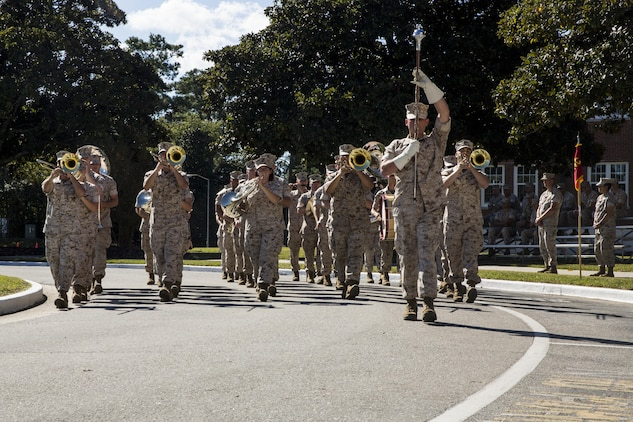 The 2nd Marine Division Band performs during a change of command ceremony in which Maj. Gen. Walter L. Miller Jr., commanding general of II Marine Expeditionary Force, assumed command from Maj. Gen. William D. Beydler at Camp Lejeune, N.C., Oct. 22, 2015. Miller, who arrived at II MEF following a stint as Chief of Staff for U.S. Special Operations Command, said returning to command II MEF forces provides him the opportunity to expand on his predecessor's success in preparing the unit to defend the nation as an elite fighting force.