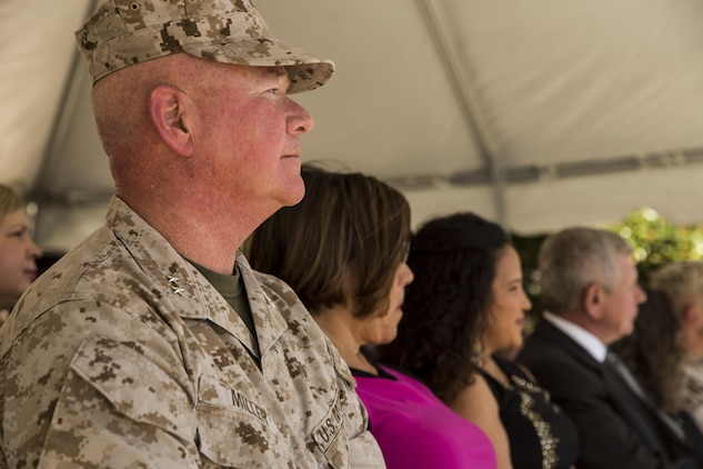 """Maj. Gen. Walter L. Miller Jr., commanding general of II Marine Expeditionary Force, observes as the 2nd Marine Division band plays during a change of command ceremony in which Miller assumed command from Maj. Gen. William D. Beydler at Camp Lejeune, N.C., Oct. 22, 2015. Beydler took command of II MEF in July of 2014 and immediately focused his attention on II MEF readiness to deploy, employ and redeploy forces in support of Geographic Combatant Commander requirements and the National Security Strategy. His force preservation and community outreach initiatives such as the new """"Protect What You've Earned"""" campaign were designed to keep Marines prepared for the mission."""