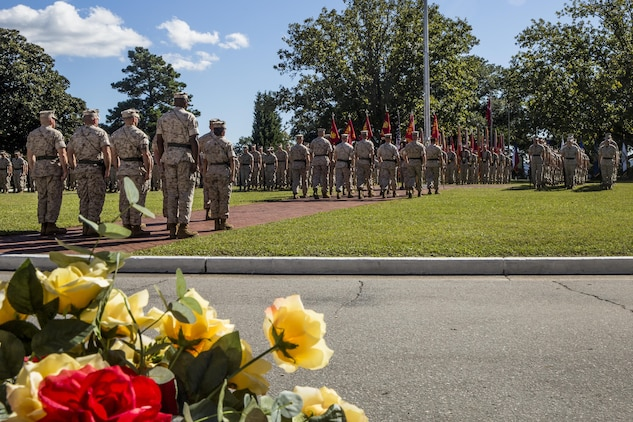 Marines and sailors with II Marine Expeditionary Force Headquarters Group, 2nd Marine Division, 2nd Marine Aircraft Wing, 2nd Marine Logistics Group, 22nd Marine Expeditionary Unit and 24th Marine Expeditionary Unit stand in formation during a change of command ceremony at Camp Lejeune, N.C., Oct. 22, 2015. During the ceremony, Maj. Gen. Walter L. Miller Jr., commanding general of II MEF, assumed command of the MEF from Maj. Gen. William D. Beydler.
