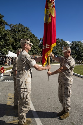 Sergeant Maj. Bryan K. Zickefoose, II Marine Expeditionary Force sergeant major, passes the colors to Maj. Gen. William D. Beydler, former II MEF commanding general during a change of command ceremony at Camp Lejeune, N.C., Oct. 22, 2015. During the ceremony, Maj. Gen. Walter L. Miller Jr., commanding general of II MEF, assumed command of the MEF from Beydler.