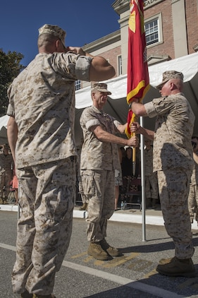 Maj. Gen. Walter L. Miller Jr. (right), commanding general of II Marine Expeditionary Force, receives the II MEF colors from Maj. Gen. William D. Beydler, former commanding general, during a change of command ceremony at Camp Lejeune, N.C., Oct. 22, 2015. Miller, who arrived at II MEF following a stint as Chief of Staff for U.S. Special Operations Command, said returning to command II MEF forces provides him the opportunity to expand on his predecessor's success in preparing the unit to defend the nation as an elite fighting force.