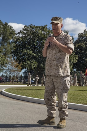 Gen. John M. Paxton, Assistant Commandant of the Marine Corps, addresses Marines, sailors, families and friends of II Marine Expeditionary Force during a change of command ceremony at Camp Lejeune, N.C., Oct. 22, 2015. During the ceremony, Maj. Gen. Walter L. Miller Jr., commanding general of II MEF, assumed command from Maj. Gen. William D. Beydler.